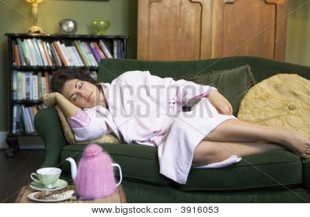 Woman Asleep On Sofa