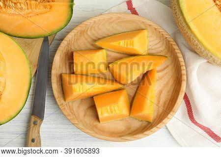Tasty Fresh Cut Melon On White Wooden Table, Flat Lay