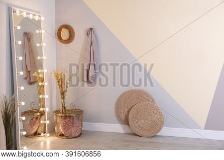 Full Length Dressing Mirror With Lamps In Stylish Room Interior