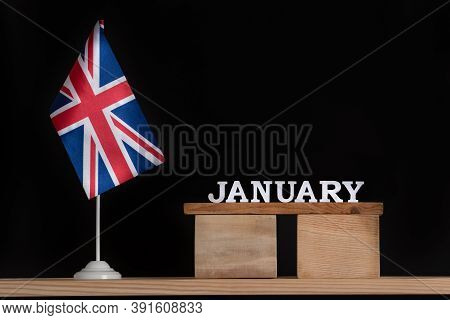 Wooden Calendar Of January With Great Britain Flag On Black Background. Holidays Of Uk In January.