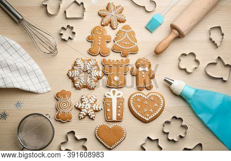 Christmas Tree Shape Made Of Delicious Gingerbread Cookies Surrounded By Kitchen Utensils On Wooden