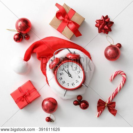 Flat Lay Composition With Alarm Clock And Christmas Decor On White Background. New Year Countdown