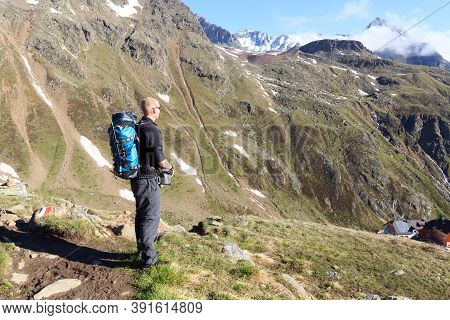 Man Looking At Mountain Panorama With Blue Sky In Tyrol Alps, Austria
