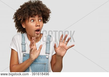 Scared Horrified Dark Skinned Lady Keeps Breath, Hands In Protective Gesture, Notices Something Awfu
