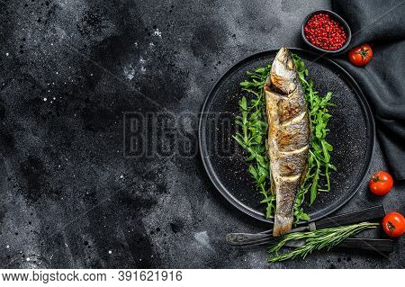 Bbq Sea Bass Fish With Arugula, Fried Sea Bass. Black Background. Top View. Copy Space