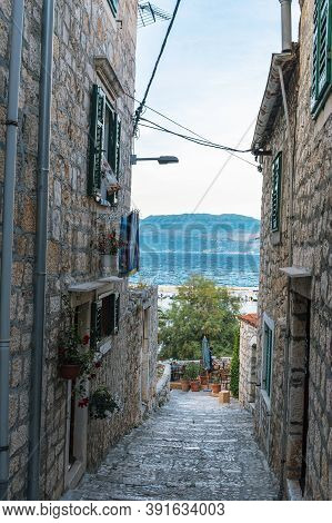 Narrow Old Street In Sutivan Town, Brac, Croatia.