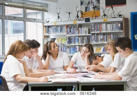 Teen Pupils Studying In School Library
