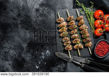 Skewered And Grilled Chicken Hearts. Yakitori. Black Background. Top View. Copy Space