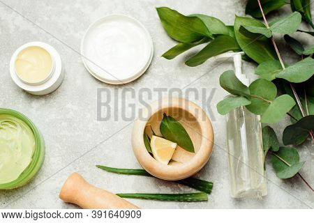 Flat Lay Composition With Cosmetic Products On Grey Background. Gel And Cream Made From Natural Ingr