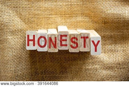 Honesty Word Written On Wood Blocks. Honesty Text On Table, Business Concept. Beautiful Canvas Backg