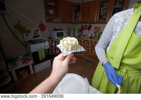 A Woman In A Medical Mask And Rubber Gloves Makes A Marshmallow Rose At Home. Cooking Sweets During