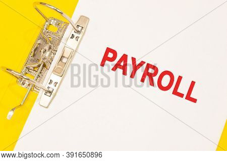 The Word Payroll On A White Background With A Yellow Folder. Finance Concept