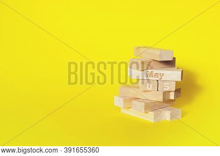 May 5th. Day 5 Of Month, Calendar Date. Wooden Blocks Folded Into The Tower With Month And Day On Ye
