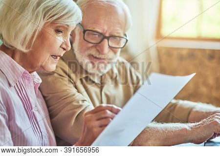 Happy Senior Family Is Managing Their Budget Together