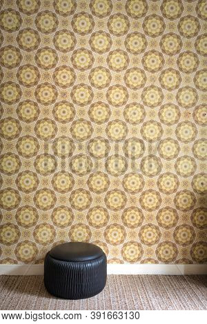 Old Room With Cheerful Vintage Wallpaper On The Wall And Black Old Pouf, Retro Interor Background Te