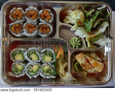 Sushi and sashimi on the metal tray
