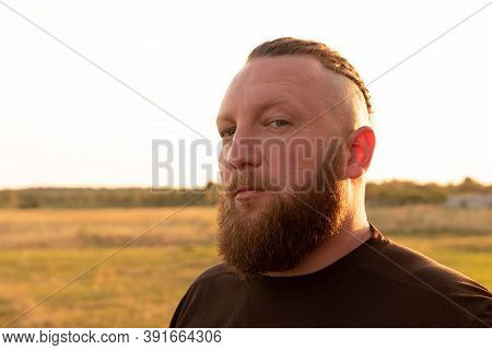 Hipster Style Bearded Man. The Attractive Man The Blonde With Long Hair Of The European Appearance W
