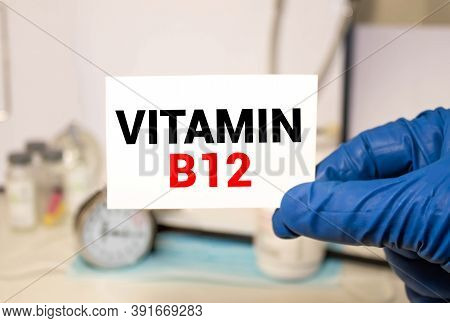 Doctor Holding A Card With Vitamin B12, Medical Concept.