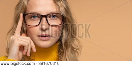 Optical Store Advertising, Eyesight Check. Close Up Portrait Of Young Blonde Woman In Glasses Lookin