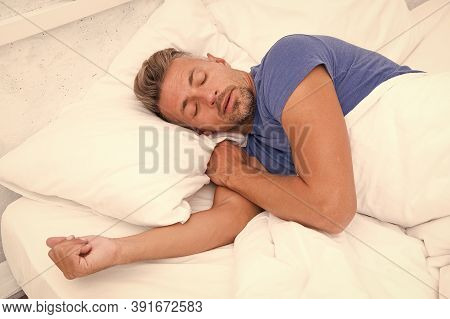 World Sleep Day. Benefits Of Good And Healthy Sleep. Breathe Easily, Sleep Well. Handsome Man In Bed