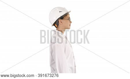 Scientist Physicist Woman Walking In Lab Coat And Hardhat On Whi