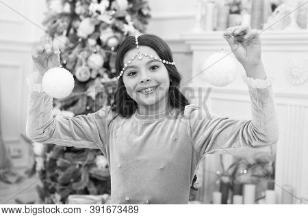Playful Mood. New Year Eve. Dreams Come True. Christmas Decorating Ideas. Child Smiling Girl Hold Ch