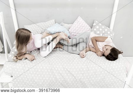 Closest Friends. Pajamas Party. Girls Sisters Having Fun. Sisters Joking Laughing At Home. Cozy Conv