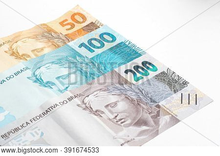 Brazilian Money, Fifty, One Hundred And Two Hundred Real Banknote. Front Of The Real Bill, High Valu