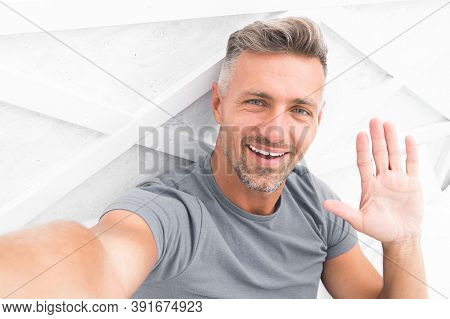 Hi There. Man Taking Selfie Photo Smartphone Waving Hand. Streaming Online Video. Mobile Internet. S