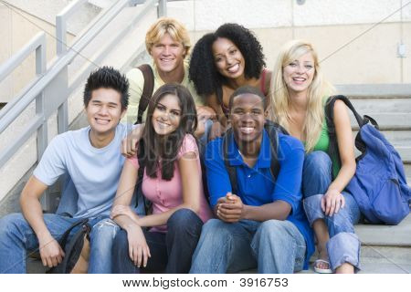Six people sitting on staircase outdoors smiling poster