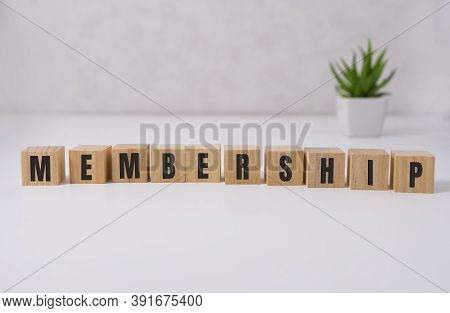 Membership Word On Wooden Cubes On White Background. Business Concept.