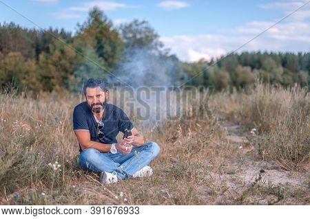 Stylish Brutal Vape Man Smoking An Electronic Cigarette. Electronic Cigarette As Alternative To Toba