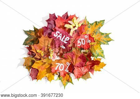 A Bunch Of Autumn Colored Leaves With The Inscription Sale With 50 And 70 Percent. Isolate With Shad