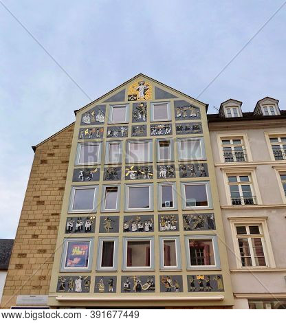 Traditional House With Religious Themed Pictures On Facade In Trier, Rhineland-palatinate, Germany -