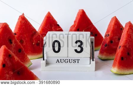Wooden Calendar And Slices Of Ripe Watermelon. 03 August, National Watermelon Day. Lots Of Red Water