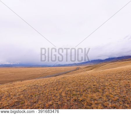The Road Going Through The Spring Steppe Under The Heap Of Clouds Of A Storm Front. Kuraiskaya Stepp