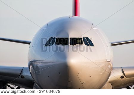 Close-up Front Of The Fuselage Of The Passenger Aircraft