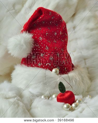Santa Claus Hat On White Fur With Luxurious Decorations
