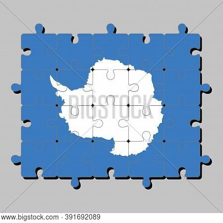 Jigsaw Puzzle Of Antarctica Flag In A Plain White Map Of The Continent On A Blue Background. Concept