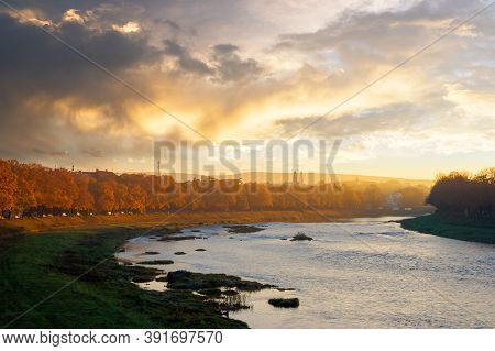 River Uzh At Sunrise. Beautiful Cityscape Autumn Scenery. Linden Alley In Fall Color In Morning Ligh