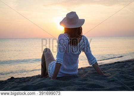 Traveler Girl In Sunset On Tropical Beach. Young Girl Traveler On Beach In Sunset. Traveler Girl In