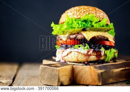 Beef Burger.fresh Tasty Burger On A Black Background.hamburger.delicious Grilled Angus Burger With C