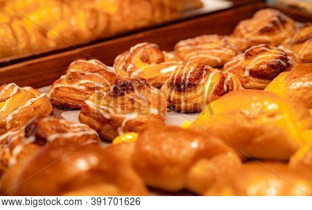 Bakery In Brown Wooden Tray In Bakery Shop. Fresh Bake Pastry Product. Sweet Bread Display On Counte