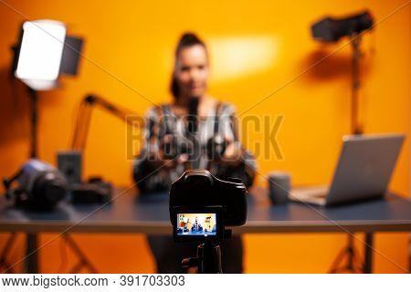 Professional Camera Recording Vlog Of Famous Blogger. New Media Star Influencer On Social Media Talk