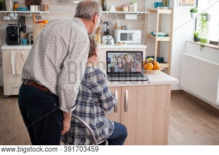 Senior Retired Couple Talking With Niece Via Internet Video Call. Online Call With Daughter And Niec