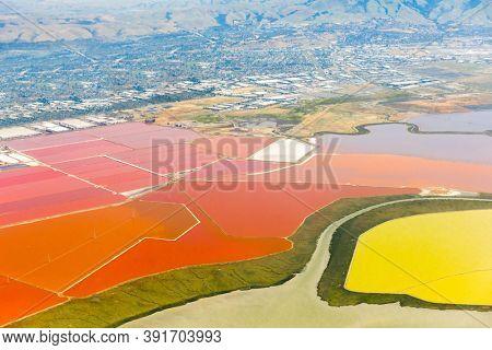 Aerial photo of vivid red salt ponds at Don Edwards San Francisco Bay National Wildlife Refuge. California, USA