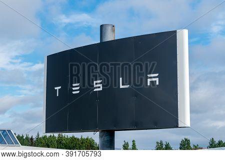 Reykjavik, Iceland - June 20, 2020: Sign Of Tesla. Tesla Motors, Inc. Is An American Electric Vehicl