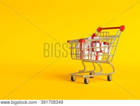 Shopping Cart With Gift Boxes, Isolated On Yellow Background Shopping Trolley. Grocery Push Cart. Mi