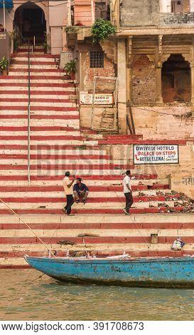 Varanasi, India - November 07, 2019: Boat And Historic Steps At The Chousati Ghat In Varanasi, India