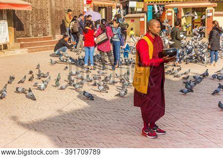 Kathmandu, Nepal - November 14, 2019: Buddhist Monk At The Boudhanath Stupa In Kathmandu, Nepal